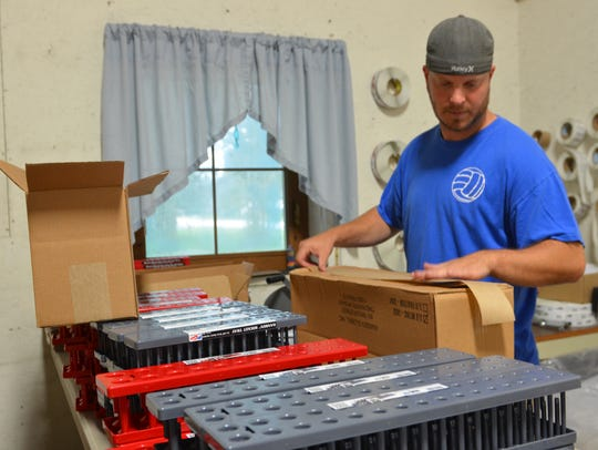 Curtis Schreiber packages up a shipment of socket trays