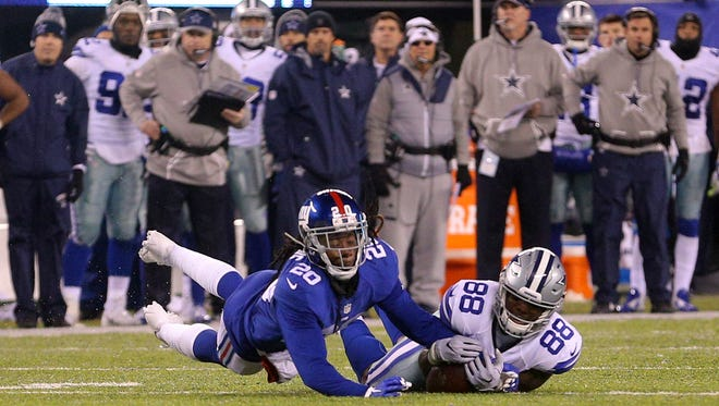 Dallas Cowboys wide receiver Dez Bryant (88) can't catch a pass on fourth down with coverage by New York Giants cornerback Janoris Jenkins during the fourth quarter at MetLife Stadium. The call on the field was a first down catch and was overturned following a review.
