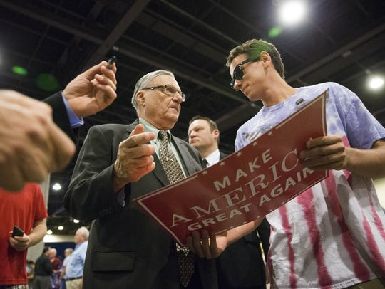 Maricopa County Sheriff Joe Arpaio signs a campaign