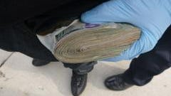 A wad of cash was recovered, Indianapolis police say, in a drug raid on the north side on Jan. 19, 2017. Police say $5,670 in cash was seized.