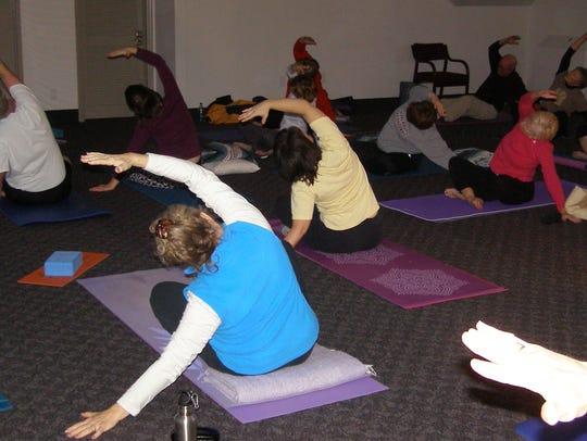 Mary Jo Frey leads a yoga class.