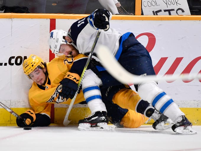 Nashville Predators left wing Kevin Fiala (22) and