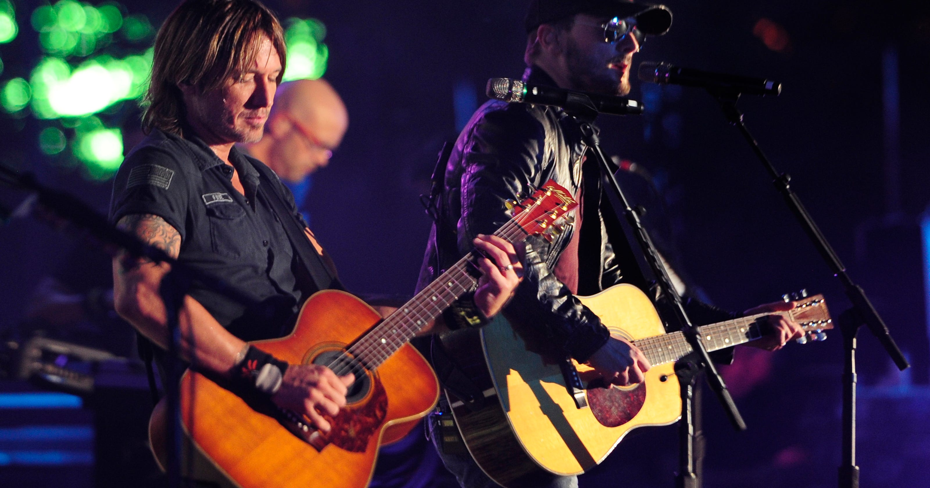 Keith Urban Eric Church Share Spotlight At Ryman