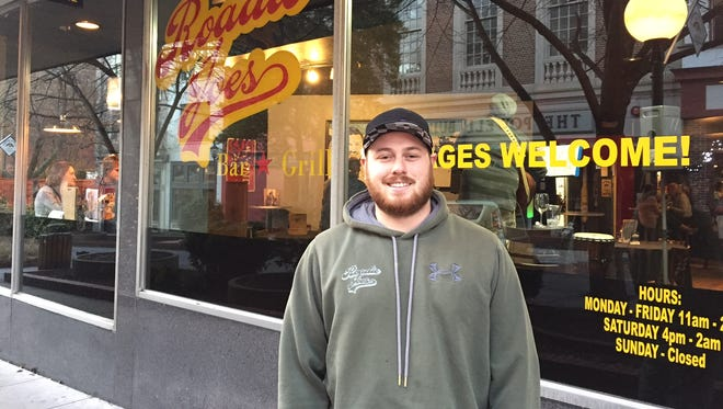 In this Jan. 28, 2017 photo, Jeremy Norton, owner of Roadie Joes on The Plaza in downtown Salisbury, stands outside his bar and grill and discusses the need for more lighting and police patrols in the trendy retail and residential neighborhood where three people were stabbed nearby early Saturday.