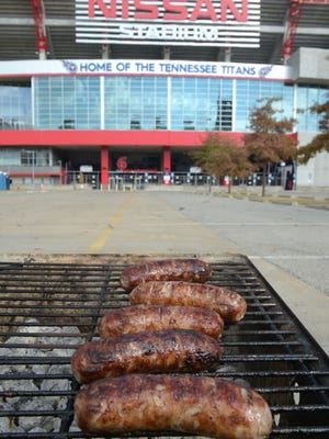 A stadium parking lot, the lure of the gridiron, and charcoal-grilled bratwurst. All is good.