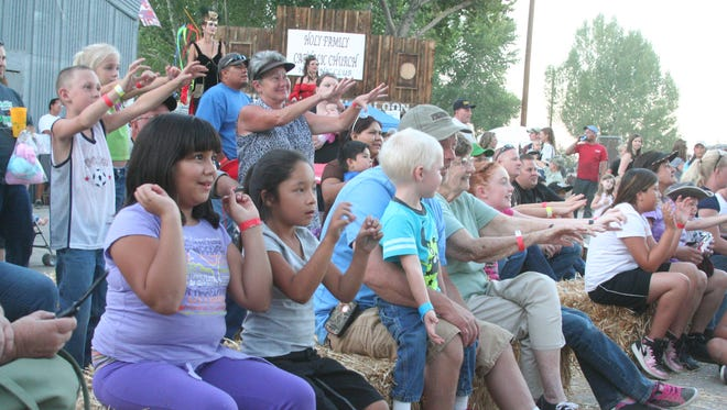 A crowd enjoys a magic show at the 2013 Lyon County Fair and Rodeo.