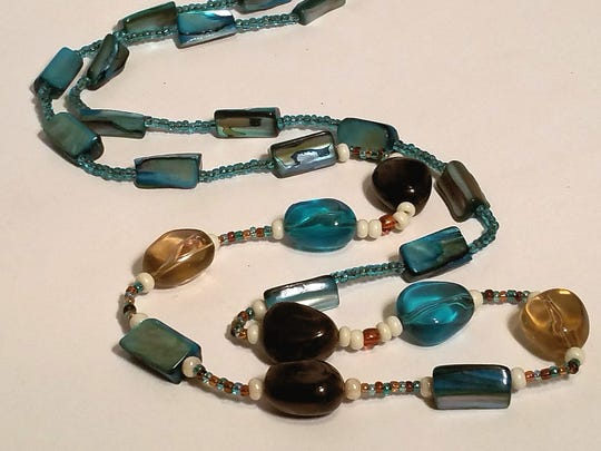 Lori Erbes' beaded necklaces are showcased in the shop.