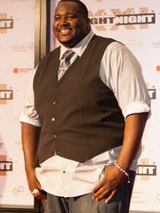 Quintin Aaron walks the red carpet during Celebrity