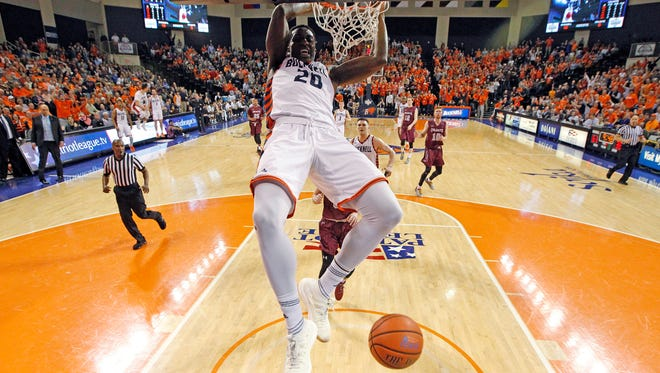 Bucknell's Nana Foulland (20) dunks against Colgate during the second half of an NCAA college basketball game for the Patriot League men's tournament championship in Lewisburg, Pa., Wednesday, March 7, 2018. Bucknell won 83-54.