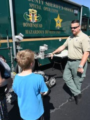Sgt. James Byers shows off the Sheriff's Office bomb disposal equipment at the Safety Fair and Bike Rodeo.