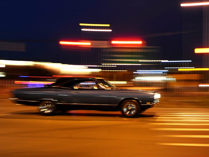 Cars make their way one last time down Woodward for
