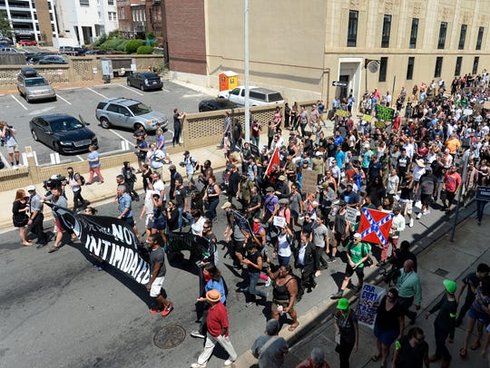 Counter protesters march against a potential white