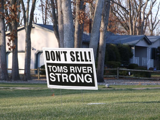 Signs posted outside of homes along Vermont Avenue.