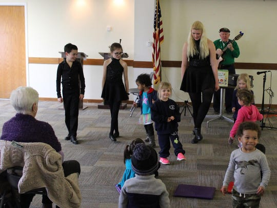 Emerald Isle students Luke Sooy, 10, (left), Maria Sooy, 11, (center) and Gwen Resch, 17, (right), teach some Irish dance steps.