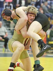 De Pere senior Trevor Turriff wrestles Pulaski's Lucas Gracyalny in the 160-pound finals at the WIAA Division 1 Green Bay Preble regional on Feb. 11. Turriff went 39-2 this season before being ruled ineligible for the postseason along with a majority of his teammates due to a scheduling error.