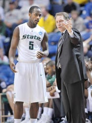 Travis Walton and Tom Izzo in the 2009 NCAA Tournament.