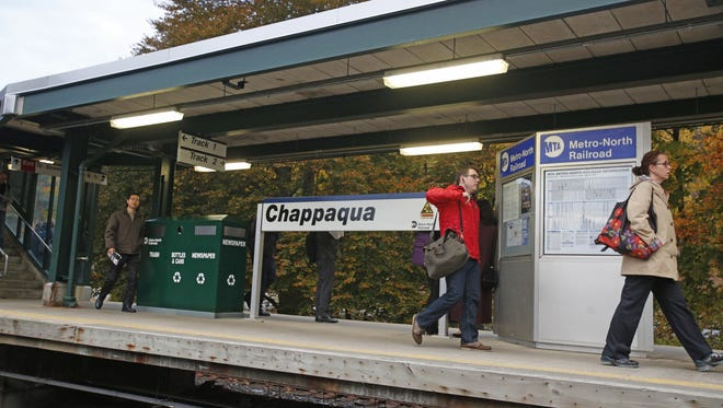 Commuters hurry along the Metro-North Chappaqua Train Station.