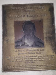 A plaque honoring Rusty Larabell, who died following