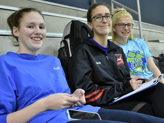 Maeve Verity (center) manages the Maine-Endwell Senior