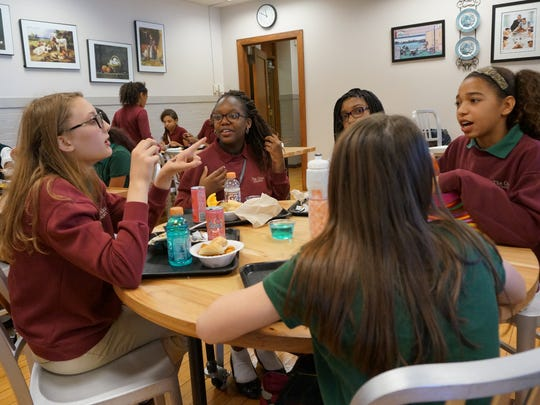 Girls talk during their lunch break at The Oaks Middle School on May 18, 2016.