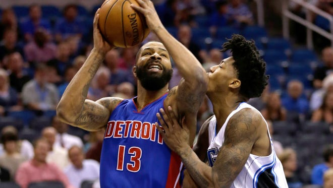 Detroit Pistons' Marcus Morris (13) goes to the basket against Orlando Magic's Elfrid Payton, right, during the first half.