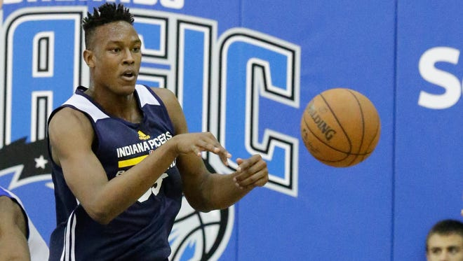 Indiana Pacers' Myles Turner passes the ball out during the first half of an NBA summer league basketball game, Wednesday, July 8, 2015, in Orlando, Fla. (AP Photo/John Raoux)