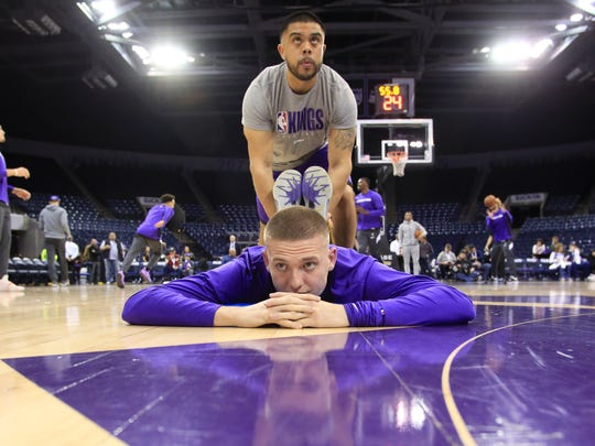 STOCKTON, CA - DECEMBER 28: Kyle Guy #7 of the Stockton Kings stretches while playing against the Santa Cruz Warriors during an NBA G-League game on December 28, 2019 at Stockton Arena Center in Stockton, California. NOTE TO USER: User expressly acknowledges and agrees that, by downloading and or using this photograph, User is consenting to the terms and conditions of the Getty Images License Agreement. Mandatory Copyright Notice: Copyright 2019 NBAE (Photo by Jack Arent/NBAE via Getty Images)