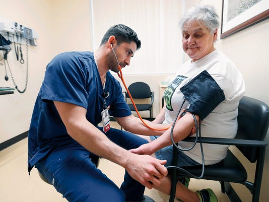 Rose Papke is checked by her nurse, Raul Zubia at Las Palmas Kidney Transplant Center. Papke said it was a no-brainer to go to the Las Palmas Kidney Transplant Clinic.