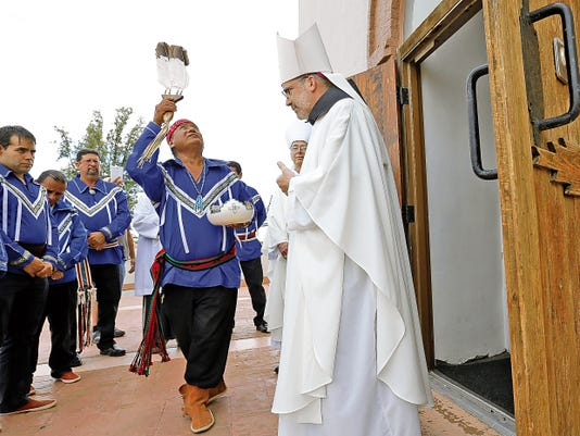 The Tiguas perform a smudging ceremony for Bishop John Stowe outside the Ysleta Mission on Wednesday before his Mass of Thanksgiving at Our Lady of Mount Carmel Parish. Stowe gave thanks for what he learned as a priest in El Paso before becoming the bishop of the Diocese of Lexington, Ky.