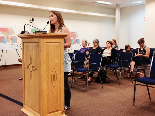 Silver City resident April Lee discusses proposed changes to the city's animal control ordinance during Tuesday's Town Council meeting. Randal Seyler - Sun-News