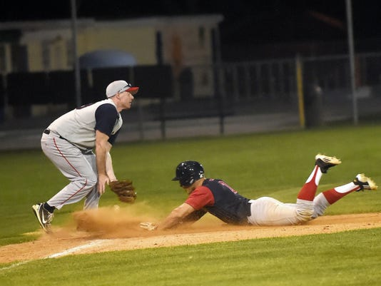 Fayetteville's Darrell Schellhase (33) lets a ball slip through his glove as Trevor Shauf (7) of Shippensburg slides into third base on Friday. Shauf would go on to drive in the game-winning run in the ninth inning of Ship's 7-6 win.