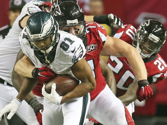 Philadelphia wide receiver Jordan Matthews runs against Atlanta Falcons outside linebacker Kroy Biermann during the second half of Monday's game. The Falcons won, 26-24.
