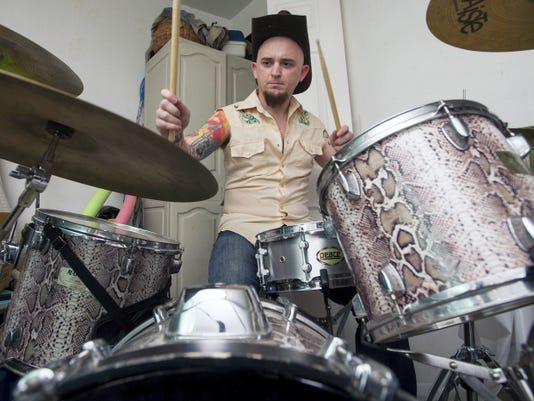 """Drummer Reese """"Cletus Coltrane"""" keeping the beat as God Bless Our Mobile Home rehearses for its first gig in two years."""