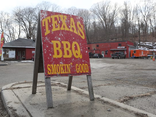 The The big Texas BBQ sign welcomes visitors to the
