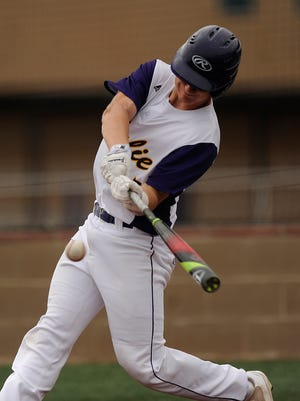 Wylie's Caleb Munton (25) hits a ball during the bottom of the fourth inning of the Bulldogs' 6-1 loss in the Abilene Invitational baseball tournament on Saturday, March 11, 2017, at Wylie High School.