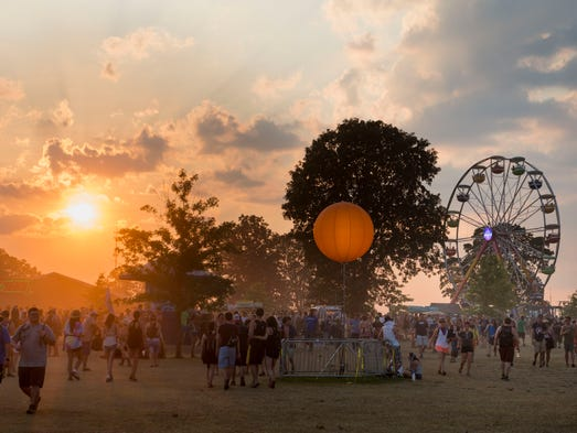 The sun sets over the Bonnaroo Music and Arts Festival,