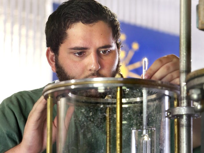 Bear Wallow Distillery Production Manager Adam Spagnuolo checks the spirit safe on the receiving tank to check the proof of corn whiskey being produced at the distillery, Indiana's first retail distillery, on Wednesday, July 30, 2014. The distillery, with retail, production and bottling space, opens on August 1 in Nashville at 4484 E. Old State Road 46, about five miles east of Nashville proper. Spagnuolo uses corn, wheat, rye and malted barley grain for production of their whiskeys, which take seven days to make, from grain to bottle or barrel.