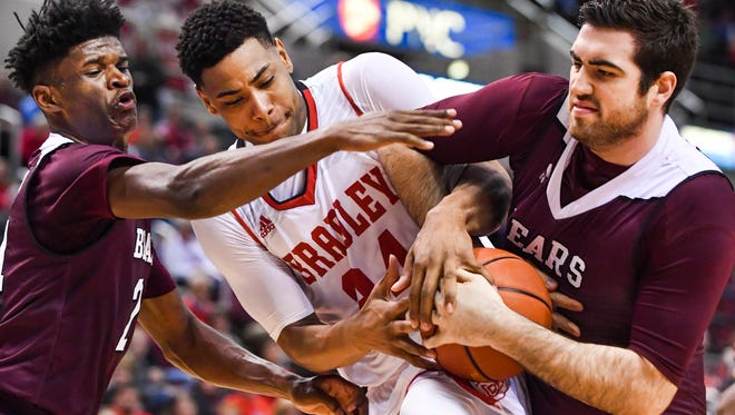 Alize Johnson of Missouri State, left, and teammate Tyler McCullough, try to pull the ball away from Bradley's Alex Foster during Wednesday's game at Carver Arena.