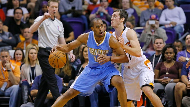 Denver Nuggets guard Arron Afflalo (10) works against Phoenix Suns guard Goran Dragic (1) during the first half of their NBA Wednesday, Nov. 26, 2014 in Phoenix.