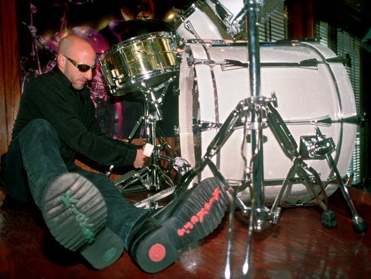 Kenny Aronoff adjusts a drum-kit display at the Hard