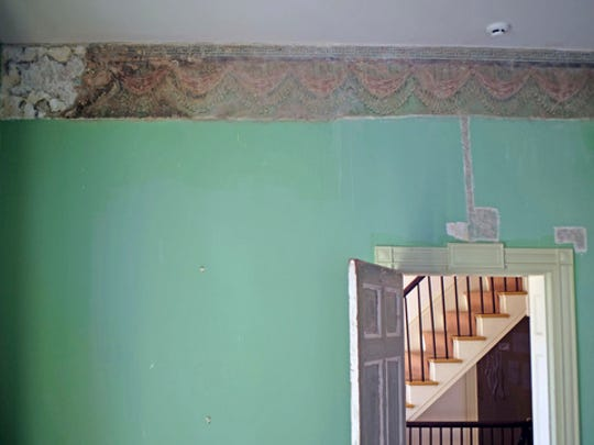 This Nov. 17, 2016 photo provided by the Thomas Cole National Historic Site shows a decorative border in the east parlor of the home of artist Thomas Cole, in Catskill, N.Y. Not only did Cole paint mountainous landscapes that defined the Hudson River School. He painted on his parlor walls in Catskill. The decorative patterns near the ceiling lines, hidden under layers of paint for more than a century and discovered a few years ago, are being restored and will be fully displayed when the Thomas Cole National Historic Site opens for the season in May 2017.