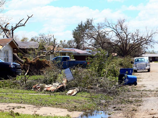 Uprooted trees surround around homes after Hurricane Harvey made landfall on Tuesday, Aug. 29, 2017, in Refugio