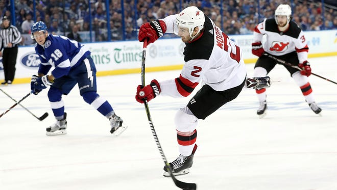 Apr 21, 2018; Tampa, FL, USA; New Jersey Devils defenseman John Moore (2) shoots against the Tampa Bay Lightning during the second period of game five of the first round of the 2018 Stanley Cup Playoffs at Amalie Arena.