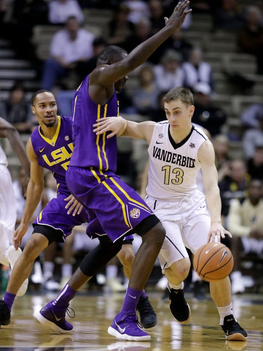 Vanderbilt guard Riley LaChance (13) dribbles around LSU forward Duop Reath in the second half of an NCAA college basketball game Saturday, Jan. 20, 2018, in Nashville, Tenn. Vanderbilt won 77-71. (AP Photo/Mark Humphrey)