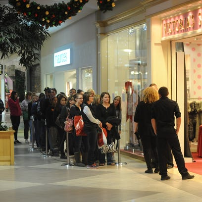 Black Friday shoppers wait outside Victoria's Secret