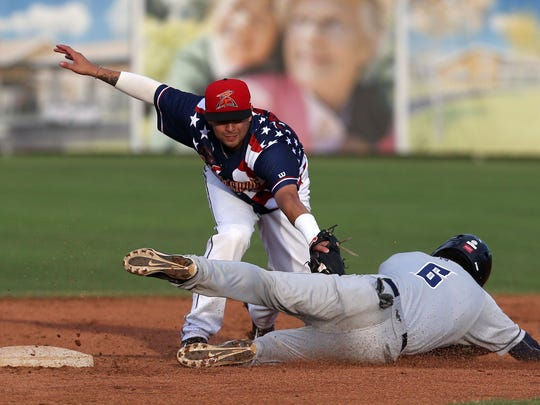 Volcanoes short stop C.J. Hinojosa catches Tri-City Dust Devils runner Luis Urias at second base on Saturday, July 4, 2015, in Keizer, Oregon.