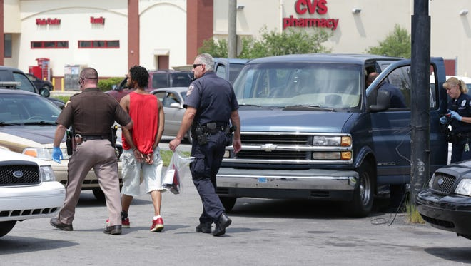 A suspect is taken into custody in Indianapolis last August after trying to flee from police.