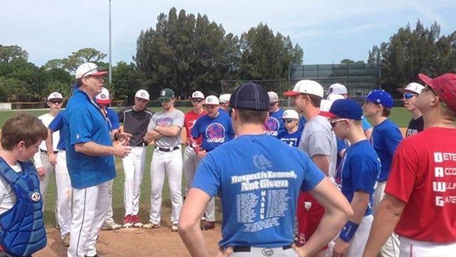 Coach Scott Berman talks to members of the Mason High School baseball team on an April trip to Vero Beach, Florida. The bus broke down three times.