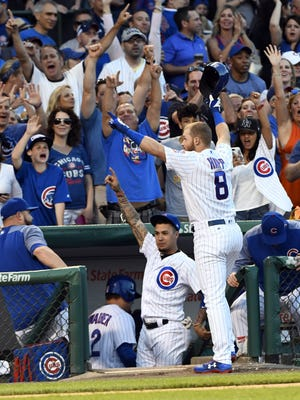 Ian Happ greets fans after his three-run home run against the St. Louis Cardinals at Wrigley Field.