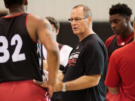 UL coach Bob Marlin instructs his men's basketball team during practice in the Moncla Indoor Facility on Tuesday.